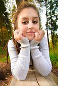 Girl on log — Stock Photo