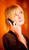 Blonde speaks by mobile phone — Stock Photo
