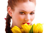 Portrait of girl with florets — Stock Photo
