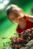 Girl and shish kebab — Stock Photo