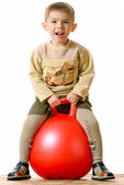 Boy on red sphere — Stock Photo