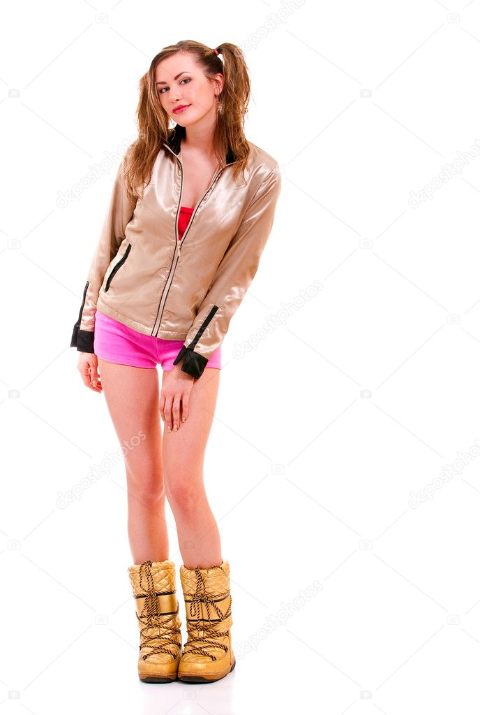 Girl in yellow winter boots, shorts and silvery jacket.  Stock Photo #1611833