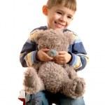 Boy with bear cub — Stock Photo