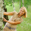 Girl keeps for birch — Stock Photo