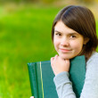 Girl with big book — Stock Photo
