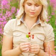Girl and wild strawberry - Stock Photo