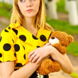 Stock Photo: Portrait of girl with teddy bear