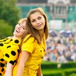 Two girls in yellow dresses — Stock Photo #2588164