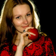 Portrait of woman with an apple. - Photo