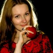 Portrait of woman with an apple. — Stock Photo