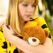 Royalty-Free Stock Photo: Portrait of girl with teddy bear
