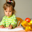 Child draws about fruit — Stock Photo