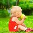 Royalty-Free Stock Photo: Baby eats an apple