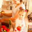 Stock Photo: Mum with daughter on kitchen