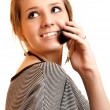 Girl speaks on cellular telephone - Stock Photo