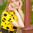 Stock Photo: Girl at lamppost