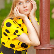 Girl at lamppost - Stock Photo