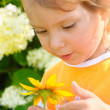Stock Photo: Girl with floret