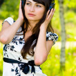 Girl in headphones on nature - Stock Photo