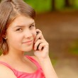 Girl speaks by mobile phone — Stock Photo