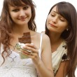 Two girls and chocolate — Stock Photo