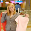 Woman chooses a blouse — Stock Photo