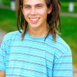 Portrait of young man with dreadlocks - Stock Photo