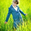 Girl among green grass — Stock Photo #2588781