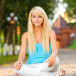 Girl in lotus pose — Stock Photo