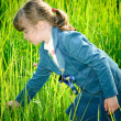 Girl among green grass — Stock Photo