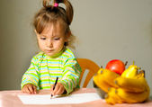 Child draws about fruit — Photo