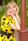 Girl at lamppost — Stock Photo