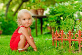 Baby sits about florist — Stock Photo