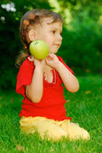 Girl with an apple — Stok fotoğraf