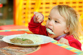Portrait of having breakfast kid. — Stock Photo