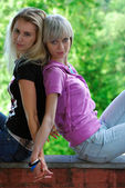 Girl-friends on a fence — Stock Photo