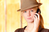 Blonde with cellular telephone — Stock Photo