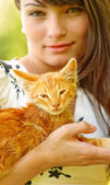 Kitten on hands at the girl — Stock Photo