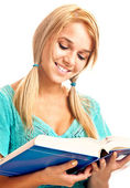 Girl reads textbook — Stock Photo