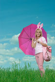Girl in suit of hare under an parasol — Stock Photo