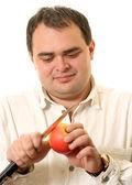Man cuts an apple — Stock Photo