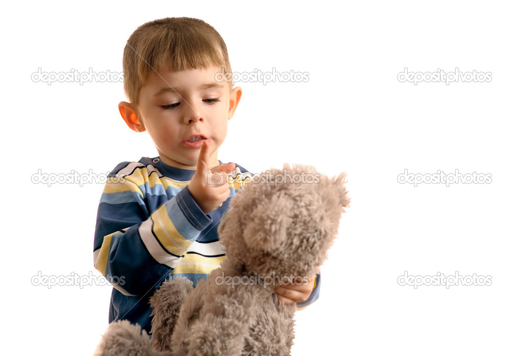 Small boy threatens with finger to teddy bear. — Stock Photo #2587891