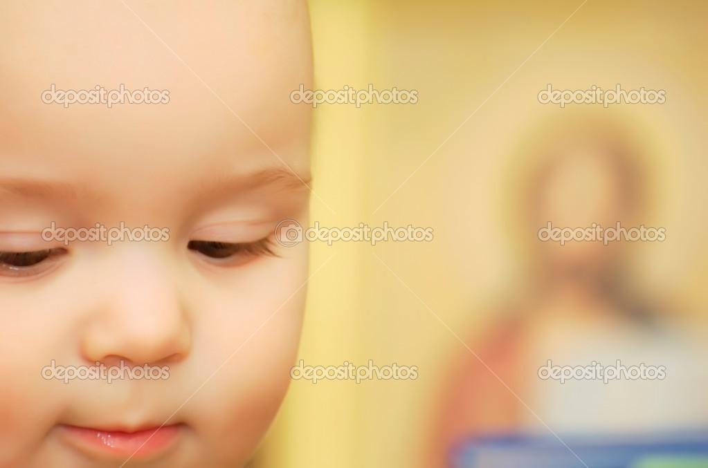 The child and an icon  Stock Photo #2588259