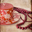 Still-life with a red candle and a beads — Stock Photo