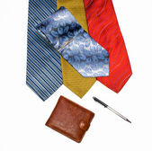 Ties are varicoloured, purse and pen — Stock Photo