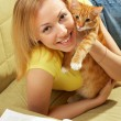 The girl with a kitten - Stock Photo