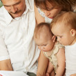 Family reading - Stock Photo