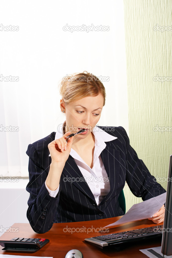 A friendly secretary/telephone operator in an office  — Stock Photo #1621266