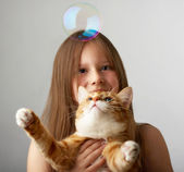 Small girl with a red cat — Stock Photo