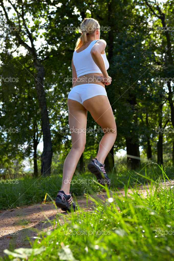Morning jog of the woman in park — Stock Photo #1903463